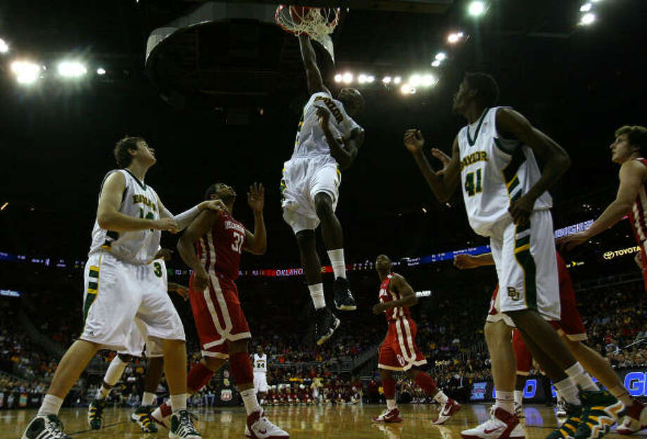 Baylor's Quincy Acy dunks the ball against the. Photo: Jamie Squire, Getty Images