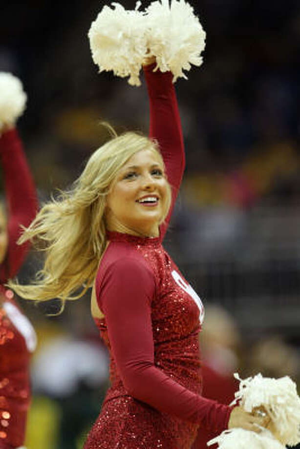 A Sooners cheerleader performs during their game against Baylor. Photo: Jamie Squire, Getty Images