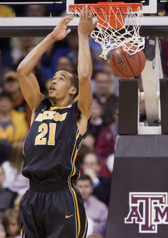 Missouri's Laurence Bowers throws down a reverse dunk in the loss. Photo: Shane Keyser, MCT