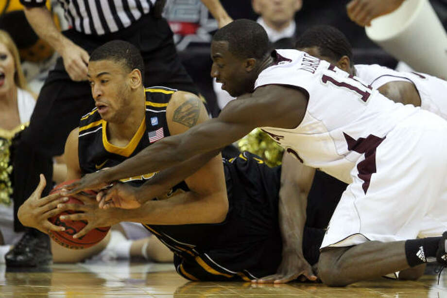 Missouri's Steve Moore fights for possesion of the ball with Texas A&M's Andrew Darko. Photo: Jamie Squire, Getty Images