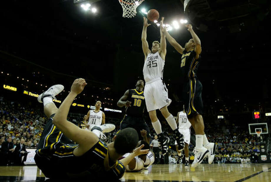 Texas A&M's Nathan Walkup grabs a rebound against Missouri. Photo: Jamie Squire, Getty Images