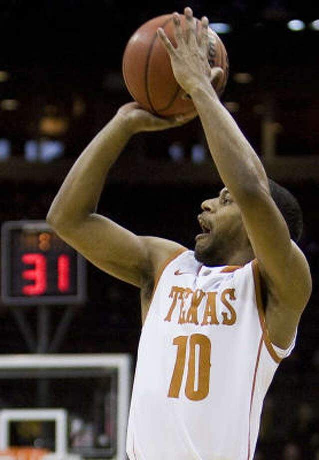 Texas guard Jai Lucas puts up a shot. Photo: SHANE KEYSER, MCT