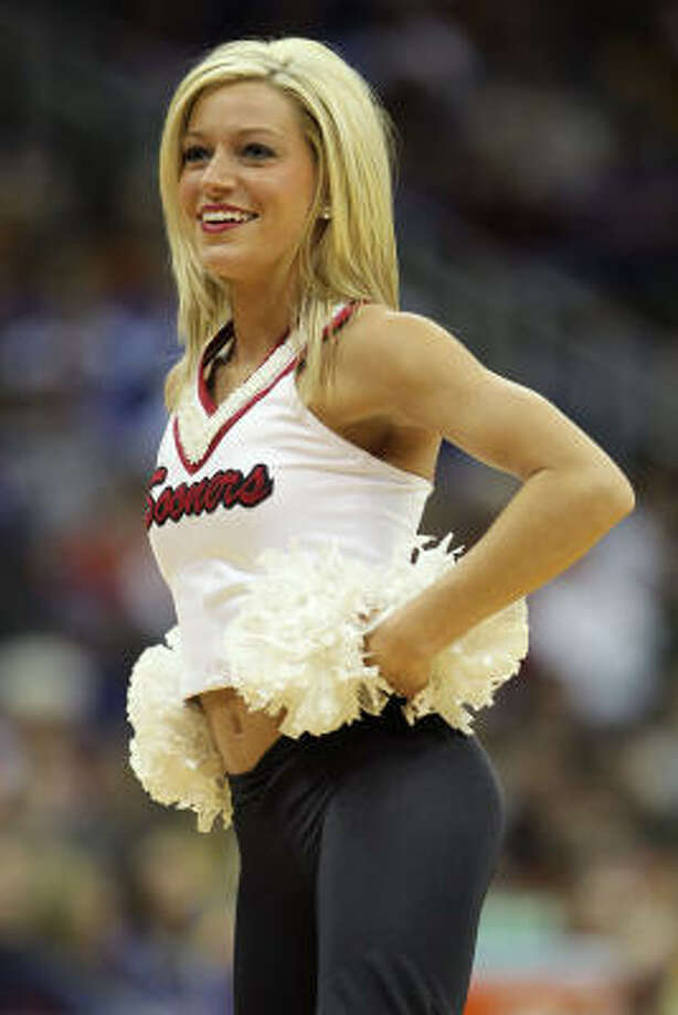 An Oklahoma Sooners cheerleader performs during the game. Photo: Jamie Squire, Getty Images