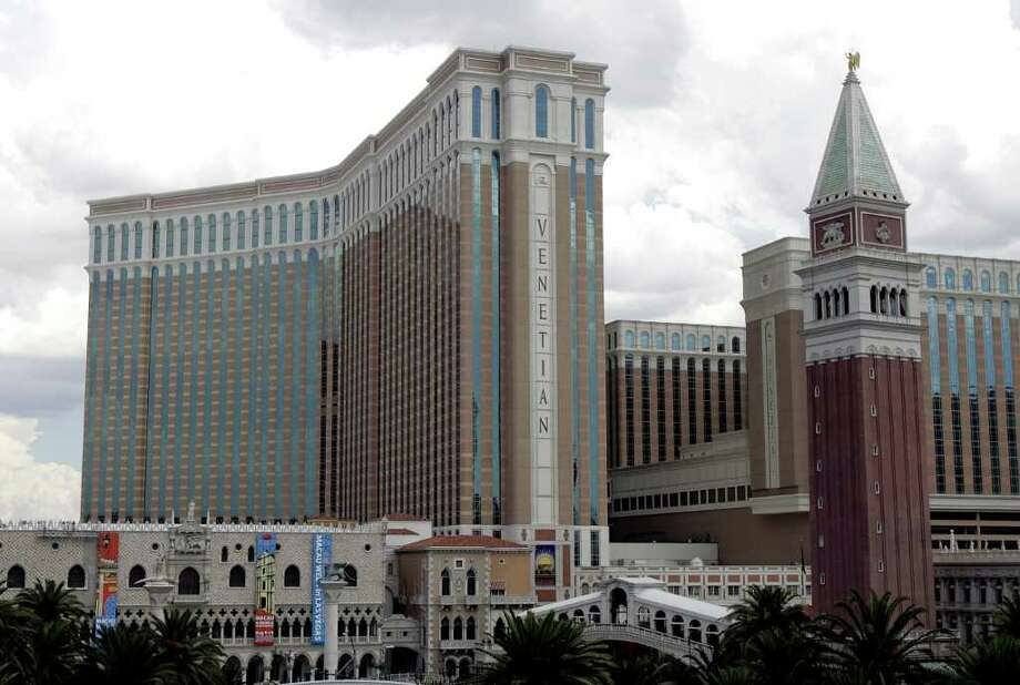 "The Venetian Hotel and Casino is seen on the Las Vegas Blvd. ""strip,""  in this  Aug. 2, 2005, file photo. Las Vegas Sands Corp., operator of the Venetian Casino Resort and the Sands Macao casino, will announce quarterly earnings on Monday, Feb. 5, 2007. (AP Photo/Joe Cavaretta, file) Photo: JOE CAVARETTA, Hearst / AP"