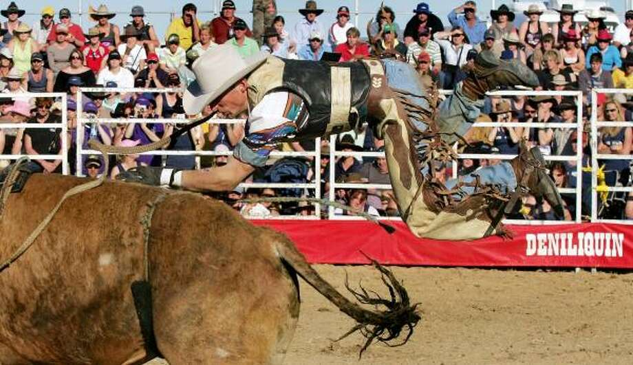 And in international bull riding: A bullrider on the Australian rodeo circuit struggles with a raging bull at a bull ride in the New South Wales outback town of Deniliquin. Photo: WILLIAM WEST, AFP/Getty Images