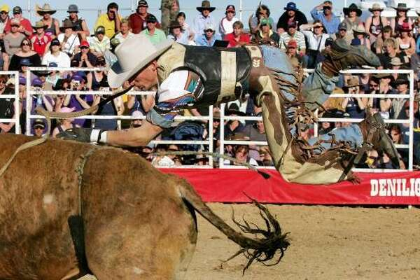 And in international bull riding: A bullrider on the Australian rodeo circuit struggles with a raging bull at a bull ride in the New South Wales outback town of Deniliquin.