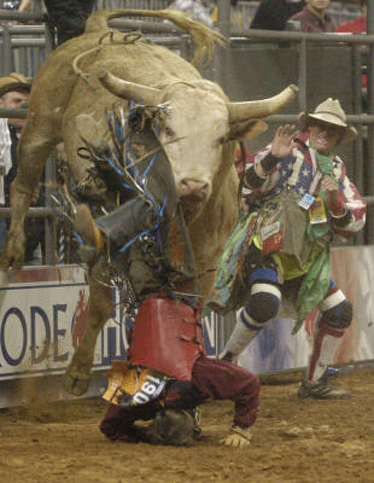 Kasey Hayes of Liberal, Kansas takes a header off a bull named Joe Joe.