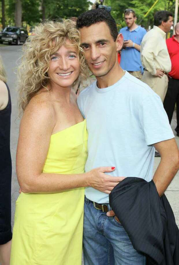 Saratoga Springs, NY - July 21, 2011 - (Photo by Joe Putrock/Special to the Times Union) - Event honoree, 2011 Kentucky Derby winning jockey, John Velazquez(right) and his wife Leona(left) pose outside of the entrance to the 18th Annual Earl B. Feiden Siro's Cup, a benefit for the Center for Disability Services Foundation.. Photo: Joe Putrock / Joe Putrock