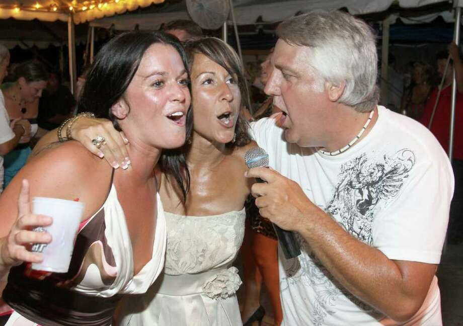 "Saratoga Springs, NY - July 21, 2011 - (Photo by Joe Putrock/Special to the Times Union) - Electric City Horns lead singer Don Duncan(right) gets some help singing the Wild Cherry classic ""Play that Funky Music"" from  Lindsay Donina(left) and Tara Garone(center) during the 18th Annual Earl B. Feiden Siro's Cup to benefit the Center for Disability Services Foundation. Photo: Joe Putrock / Joe Putrock"