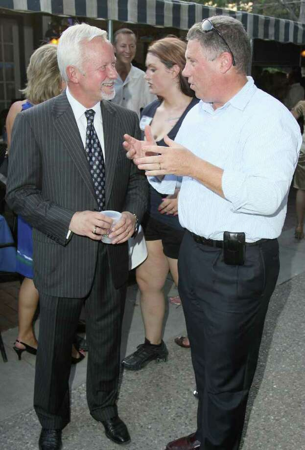 Saratoga Springs, NY - July 21, 2011 - (Photo by Joe Putrock/Special to the Times Union) - Saratoga Springs Mayor Scott T. Johnson(left) and Cohoes Mayor John T. McDonald, III(right) talk during during the 18th Annual Earl B. Feiden Siro's Cup to benefit the Center for Disability Services Foundation. Photo: Joe Putrock / Joe Putrock