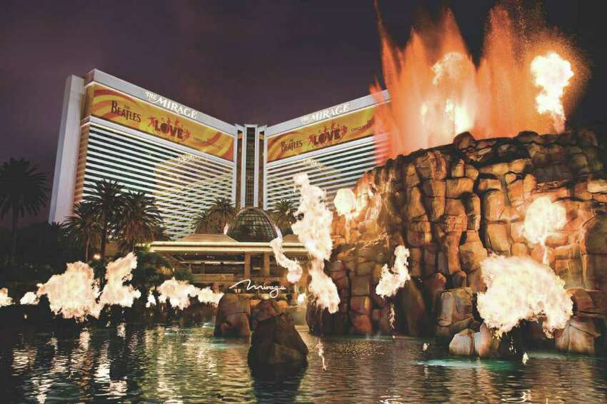 The volcano at the Mirage on the Las Vegas Strip erupts with flames dancing to music from Grateful Dead drummer Mickey Hart and Indian tabla musician Zakir Hussain.