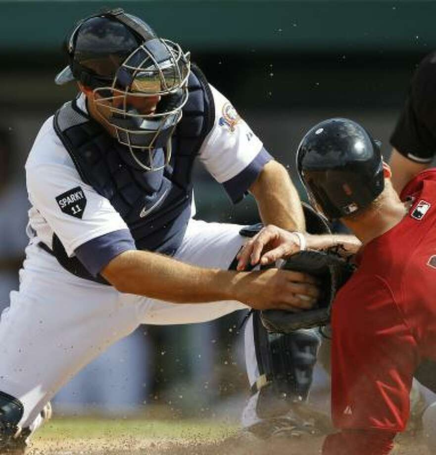 Tigers catcher Alex Avila tags out Hunter Pence. Photo: Leon Halip, Getty Images