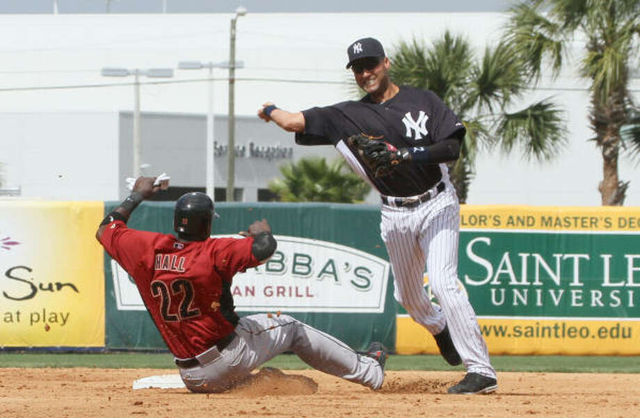 March 2: Yankees 6, Astros 5 Yankees shortstop Derek Jeter, right, turns a double play after forcing out Bill Hall at second base during the second inning. Brett Wallace was out at first. Photo: Margaret Bowles, AP
