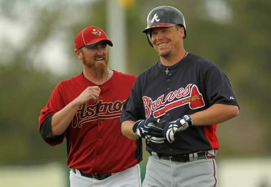 Chipper Jones and Brett Myers  of the Astros share a moment away from the action. Photo: Mike Ehrmann, Getty Images