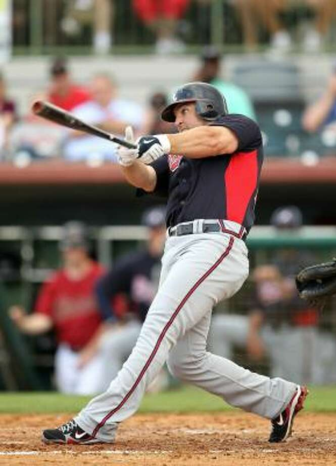 Dan Uggla of the Atlanta Braves gets a piece of a pitch. Photo: Mike Ehrmann, Getty Images