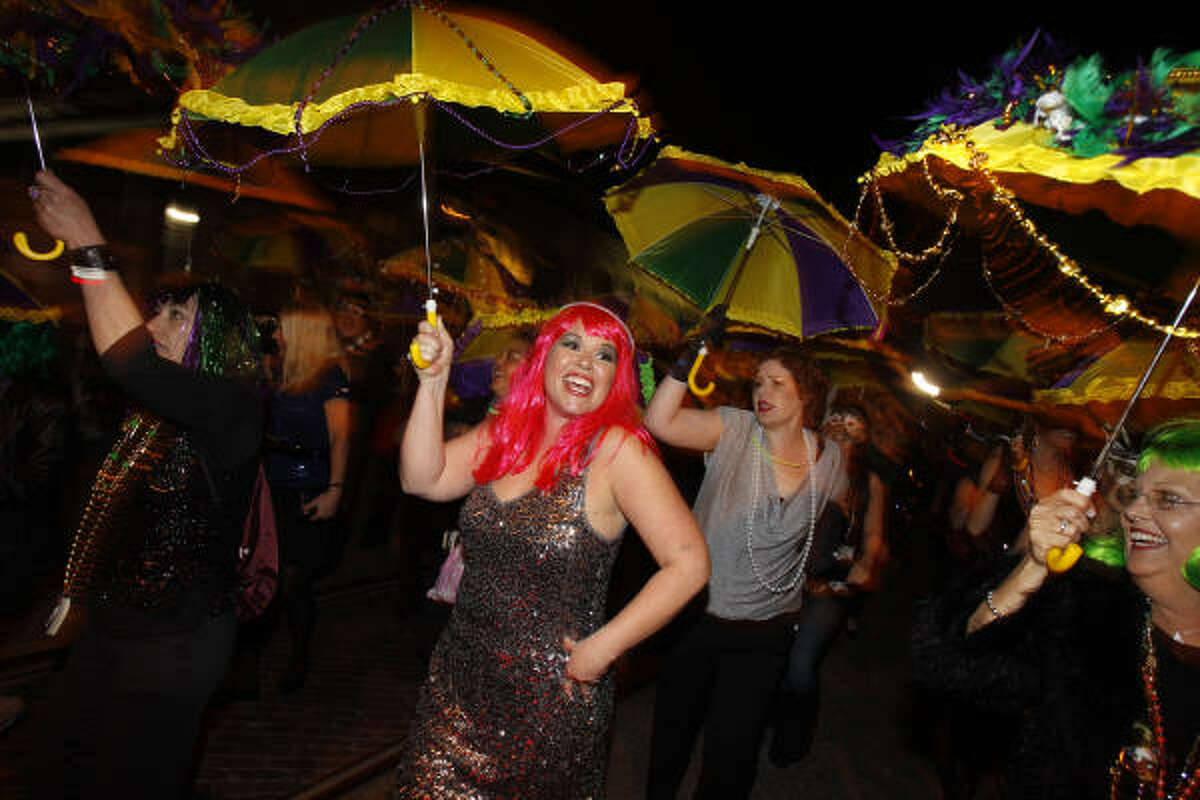 Amy Canaba of Galveston during the Funky Uptown Umbrella Brigade Parade at the 100th celebration of Mardi Gras! Galveston along the Strand.