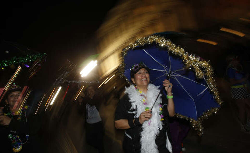 Monica Garcia of Webster during the Funky Uptown Umbrella Brigade Parade.