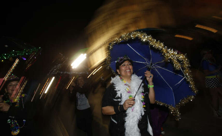 Monica Garcia of Webster during the Funky Uptown Umbrella Brigade Parade. Photo: Melissa Phillip, Houston Chronicle