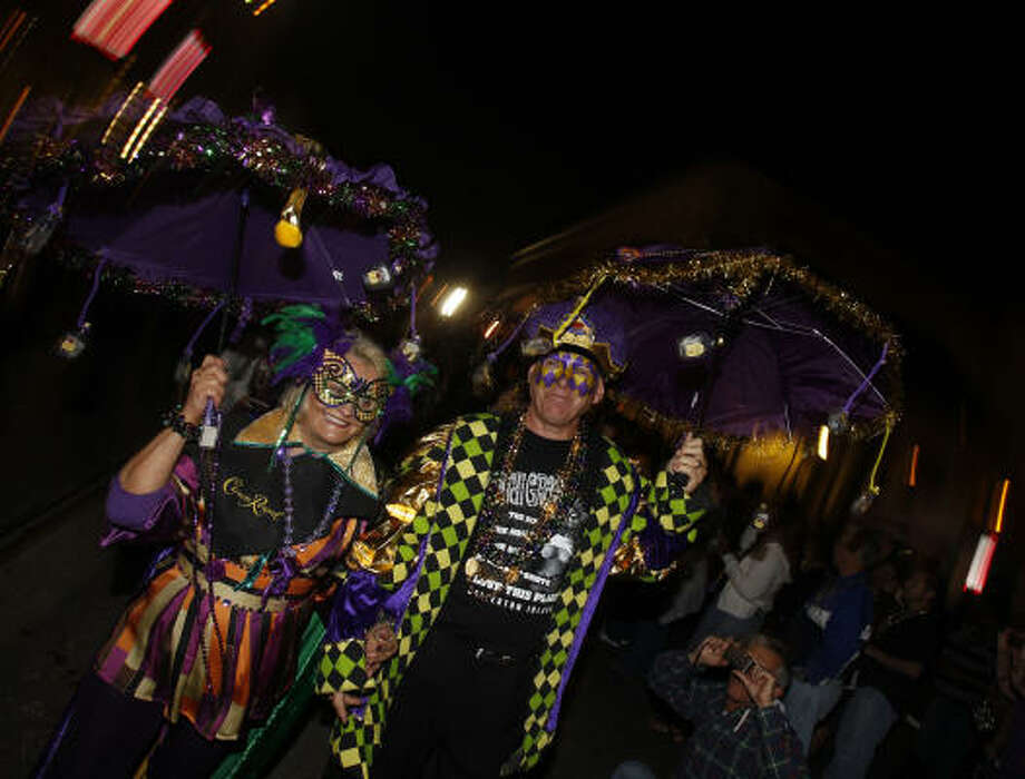 Alice and Harry Welker of The Woodlands during the Funky Uptown Umbrella Brigade Parade. Photo: Melissa Phillip, Houston Chronicle