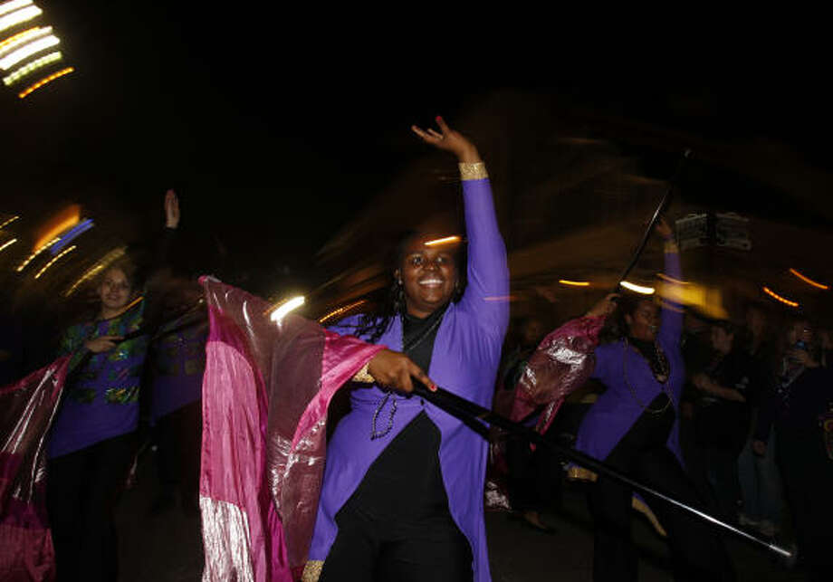 Keisha Williams, 17, with the Ball High School marching band, performs during the Funky Uptown Umbrella Brigade Parade. Photo: Melissa Phillip, Houston Chronicle