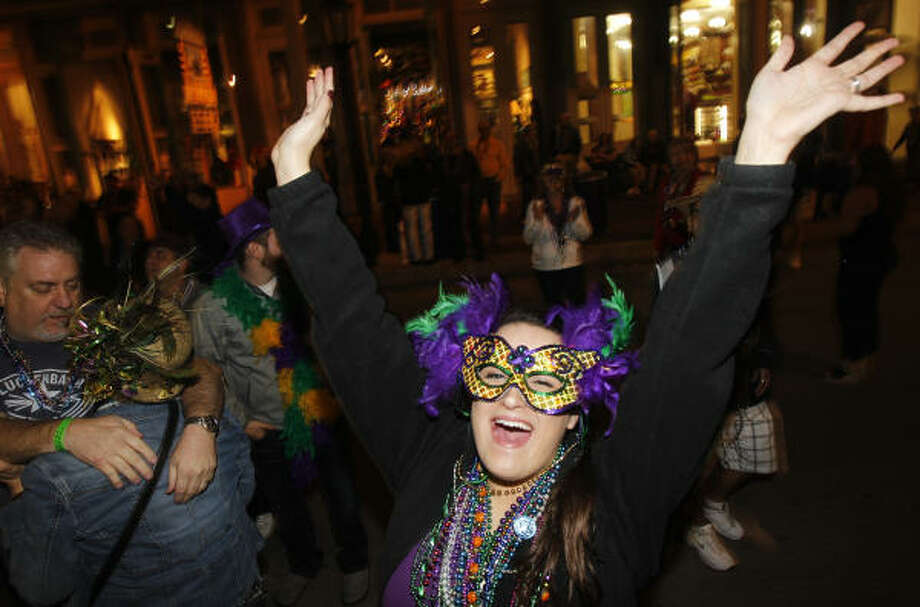 Jessica Wells of Garland and a student at A&M attends her first Mardi Gras during the 100th celebration of Mardi Gras! Galveston along The Strand. The evenings parades included the Salute to George Mitchell Parade, Funky Uptown Umbrella Brigade Parade, the Pearland High School State Champs Parade and the Krew Da' Yaga's Cafe Parade. Photo: Melissa Phillip, Houston Chronicle