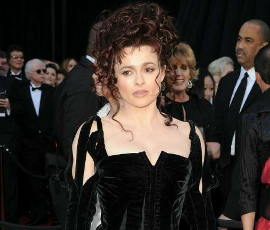 "It was very nice of the British Film Institute to think of Helena Bonham Carter's marriage to Tim Burton by giving each of them the same award on the same day. ""It's good because there's no jealousy at home,"" Bonhan Carter said. ""It's very handy and thoughtful of them to give us both one at the same time."" We read this post several times and could not stop wondering what might happen if either of them ever wins an Oscar. Photo: Jason Merritt, Getty Images"