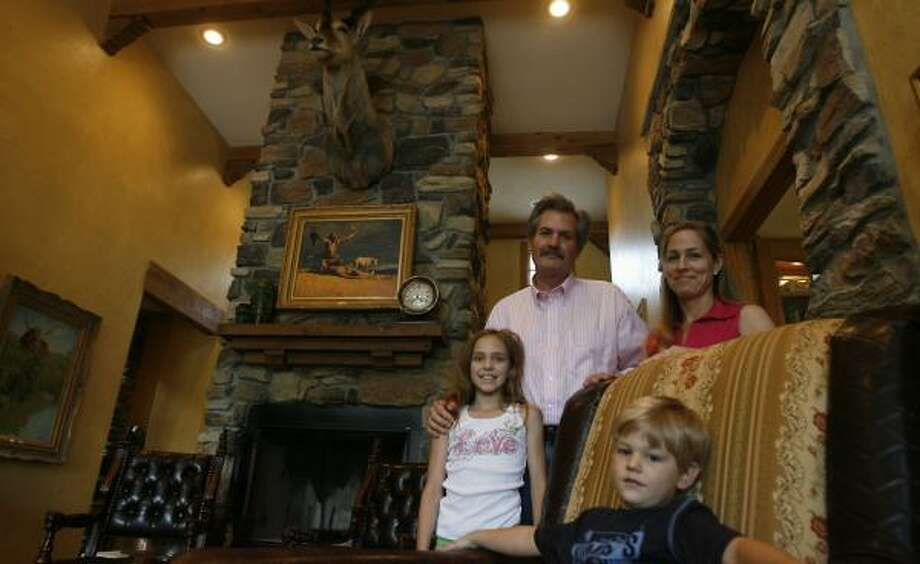 Ronald Wardell and his wife, Paige, moved into their Spring Branch-area home with son Baker and Paige's daughter, Gabby Gollihar, last spring. The 5-year-old, 5,370-square-foot house cost about $1.25 million. Photo: JAMES NIELSEN, CHRONICLE