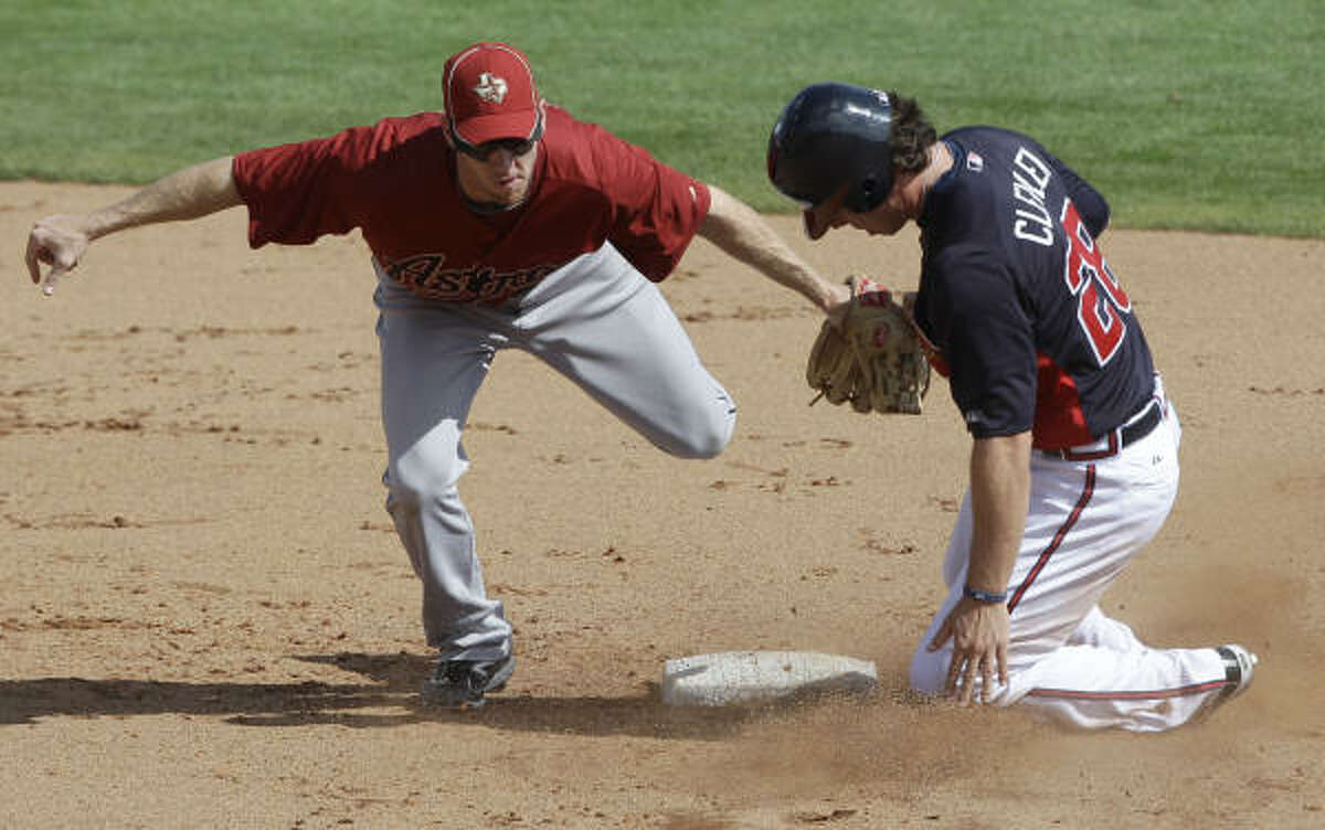 Braves' Brent Clevlen, right, is tagged out by Astros' Matt Downs, left, while trying to steal second base during the fourth inning.
