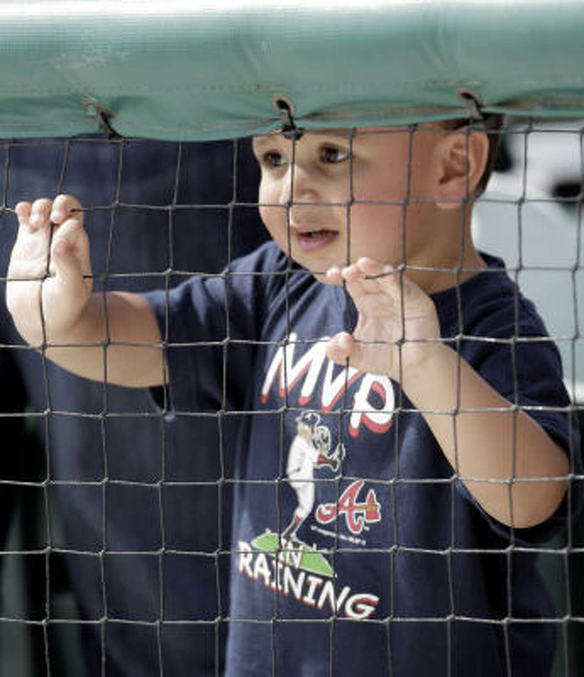 Mathew Pastor, 2, of Atlanta, watches from the stands.