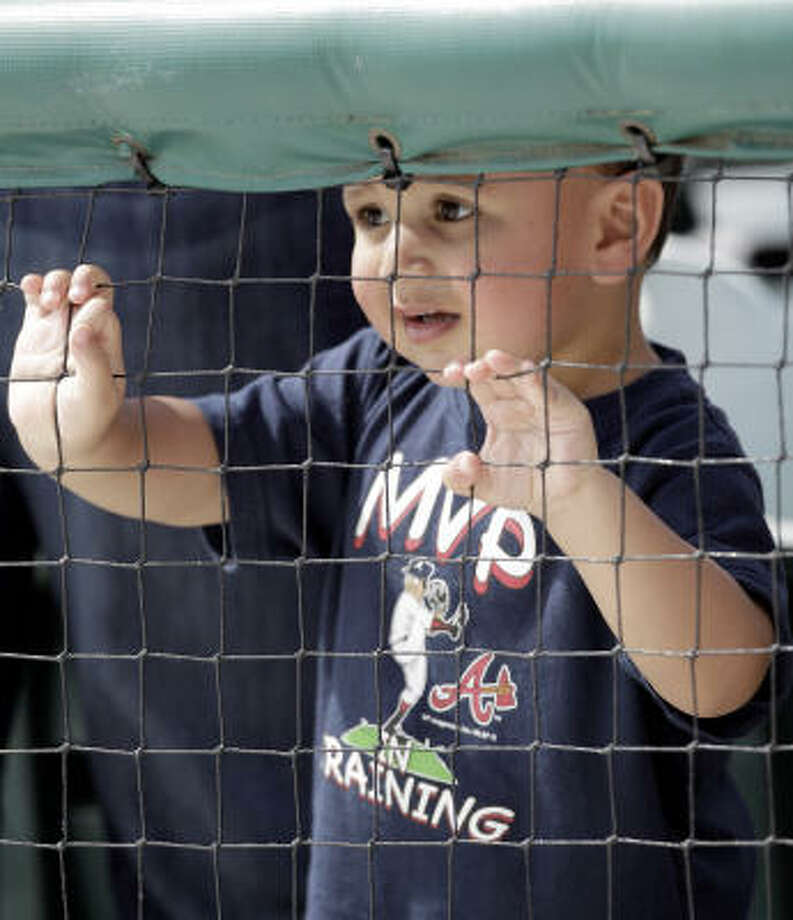 Mathew Pastor, 2, of Atlanta, watches from the stands. Photo: David J. Phillip, AP