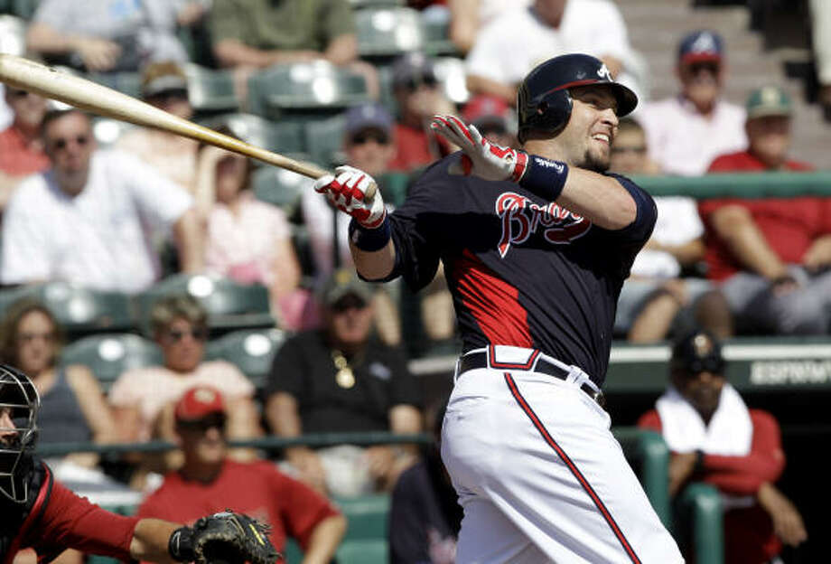 Braves' Eric Hinske watches his two-run double during the second inning. Photo: David J. Phillip, AP
