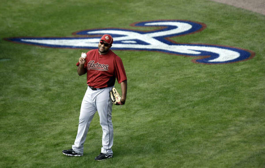 Astros left fielder Carlos Lee smiles as he warms up before the game. Photo: David J. Phillip, AP