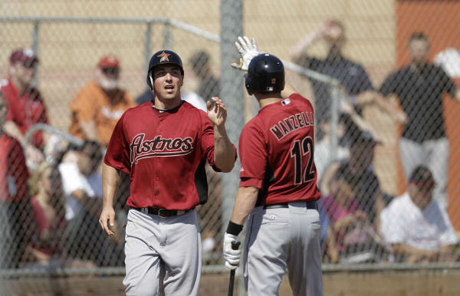 Astros outfielder Brian Bogusevic (19) and infielder Tommy Manzella (12) celebrate a run scored during the first intrasquad game. Photo: Karen Warren, Chronicle