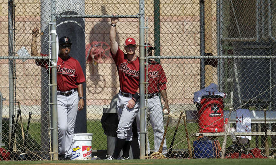 Astros first base coach Bobby Meacham (10) and catcher J.R. Towles (46) watch from the dugout during the first intrasquad game. Photo: Karen Warren, Chronicle