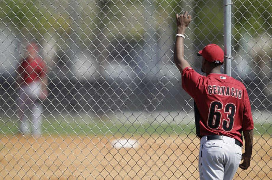 Astros pitcher Samuel Gervacio watches the intrasquad game. Photo: Karen Warren, Chronicle