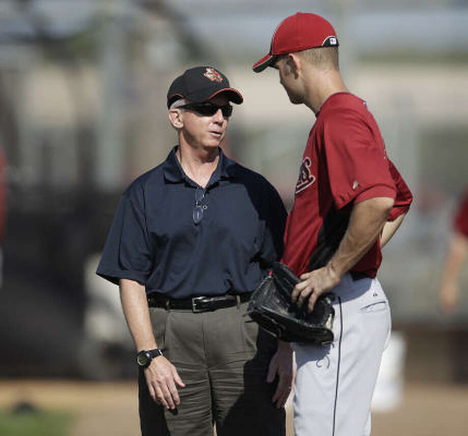 Astros general manager Ed Wade chats talks to pitcher J.A. Happ before the game. Photo: Karen Warren, Chronicle