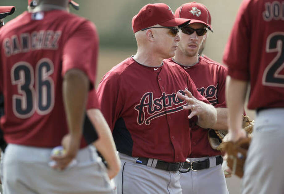 Brad Mills talks to players before a drill during the Astros spring training. Mills will be in his second season at the helm for the Astros. Photo: Karen Warren,  Chronicle