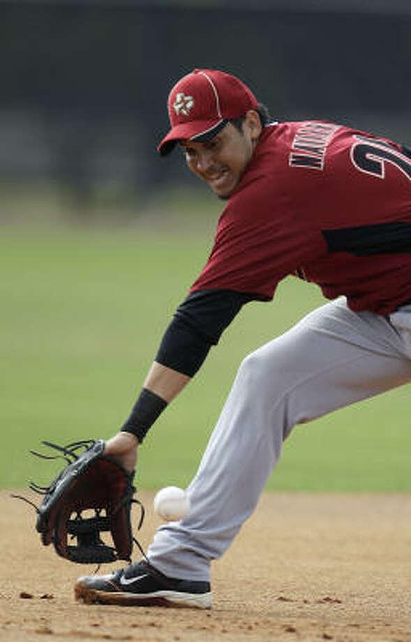 Infielder Oswaldo Navarro (26) snags a ground ball. Photo: Karen Warren, Chronicle