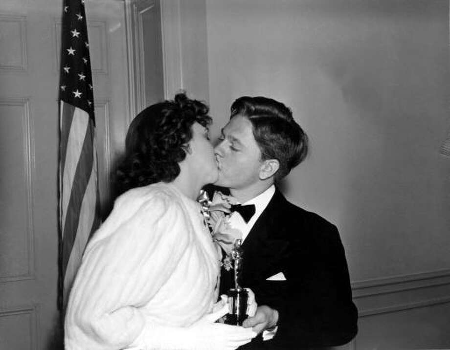Mickey Rooney, 19, Best Actor nominee (Babes In Arms, 1939). Shown kissing Judy Garland. Photo: ASSOCIATED PRESS