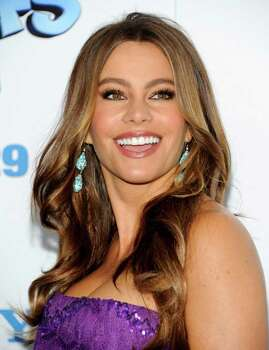 "Actress Sofia Vergara attends the premiere of ""The Smurfs"" at the Ziegfeld Theatre on Sunday, July 24, 2011 in New York. (AP Photo/Evan Agostini) Photo: Evan Agostini / AGOEV"