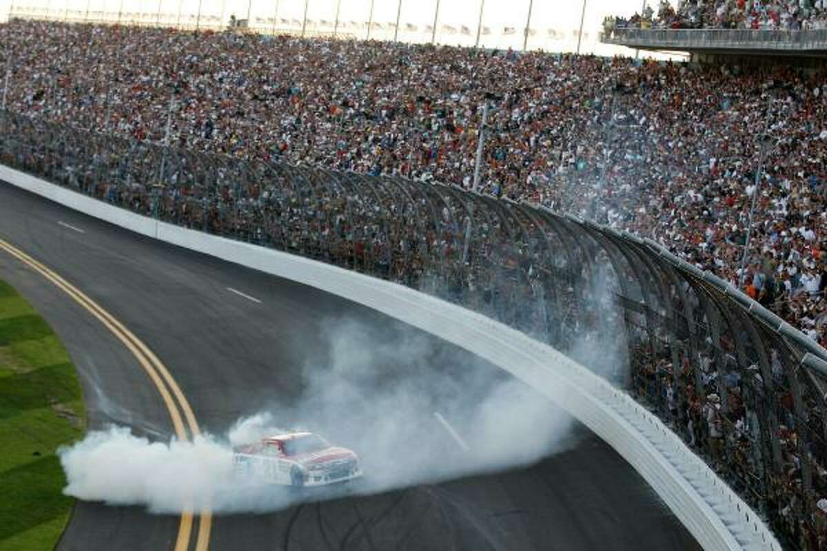 Trevor Bayne burns out in celebration at Daytona 500.