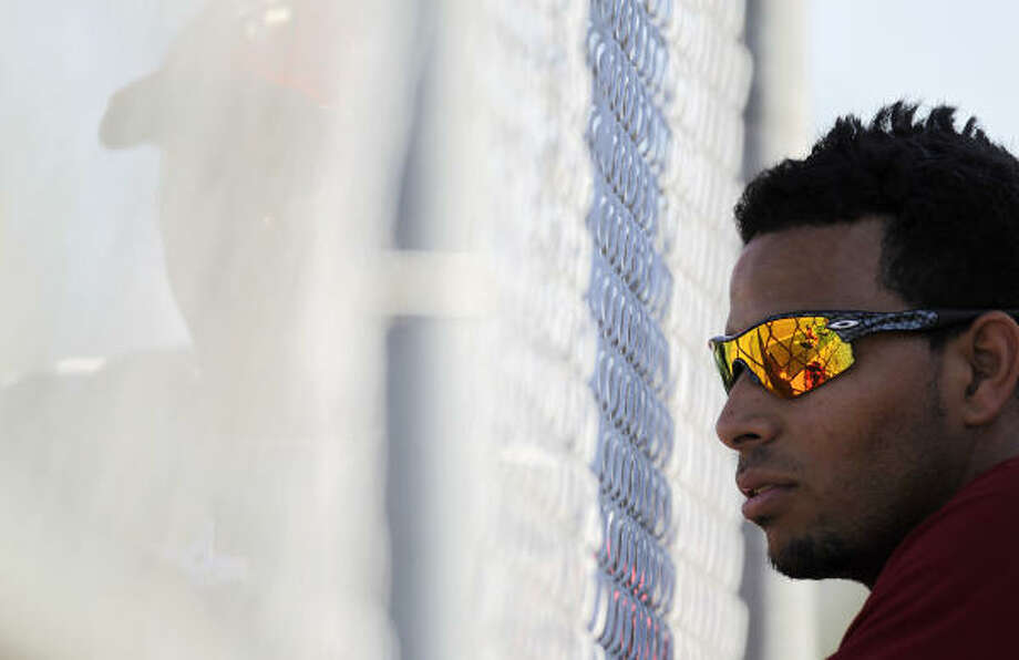 Astros infielder Angel Sanchez chats through the screen with a catcher. Photo: Karen Warren, Chronicle