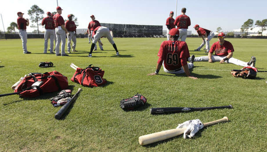 Position players stretch before their workout. Full squad workouts begin Sunday. Photo: Karen Warren, Chronicle