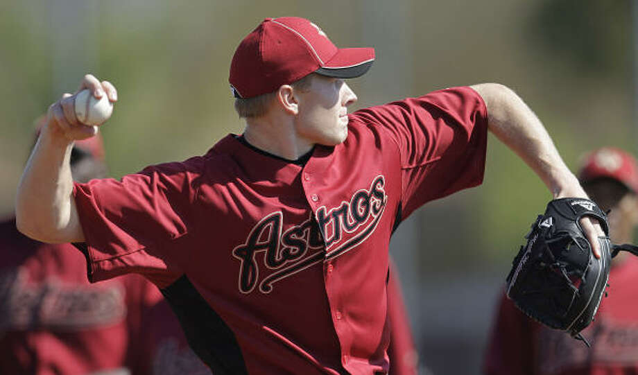 Astros pitcher Mark Melancon throws during a drill. Photo: Karen Warren, Chronicle