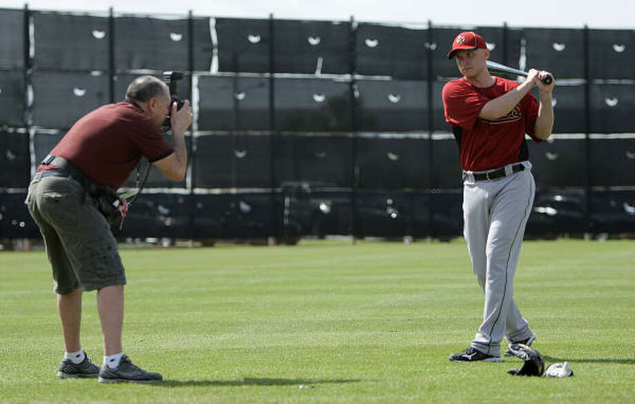 Infielder Clint Barmes has his photo taken by Steve Moore, who is shooting photos at different camps for Baseball Digest. Photo: Karen Warren, Chronicle