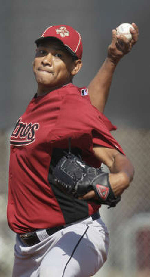 Righthander Wilton Lopez works on his pitching form. Photo: Karen Warren, Chronicle