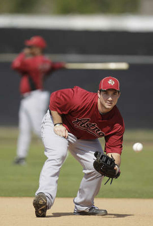 First baseman Brett Wallace catches a ball at first base. Photo: Karen Warren, Chronicle