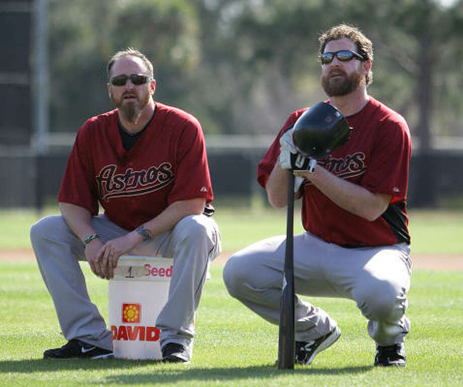 Pitchers Brett Myers, left, and Jeff Fulchino take a break during bunting drills. Photo: Karen Warren, Chronicle