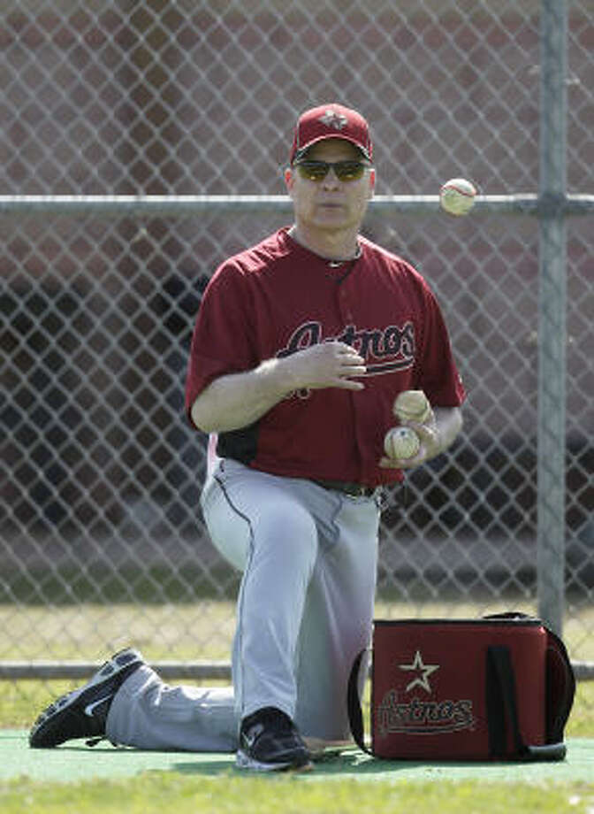 Manager Brad Mills rounds up a few baseballs. Photo: Karen Warren, Chronicle