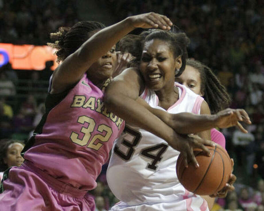 Texas A&M center Karla Gilbert (34) comes down with an offensive rebound against Baylor's Brooklyn Pope (32). Photo: Tony Gutierrez, AP